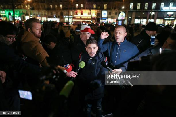 A demonstrator speaks to the press during a gathering of the quotYellow Vestsquot place de la Republique in Paris on January 3 in tribute to the dead...