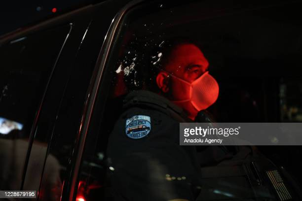 A demonstrator spit on a police vehicleâs window as thousands of Breonna Taylor protestors marched after no officers charged directly with Breonna...