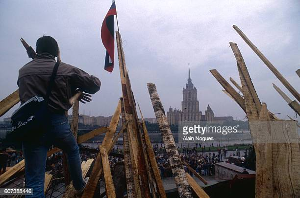 Demonstrator stands on a barricade outside the Kremlin during a 1991 coup attempt in Moscow. The Ukraina Hotel is visible in the distance. The State...