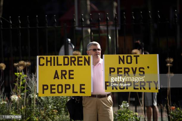 A demonstrator stands outside federal court during a bail hearing for Jeffrey Epstein July 15 2019 in New York City The judge stated he will make a...