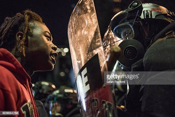 A demonstrator stares down law enforcement during protests September 21 2016 in Charlotte NC Protests in Charlotte began on Tuesday in response to...