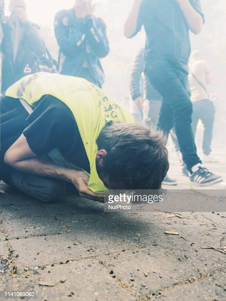 A demonstrator struggling with tears gaz in front of the hospital of quot la PitiéSalpêtrièrequot Paris May the 1th of 2019