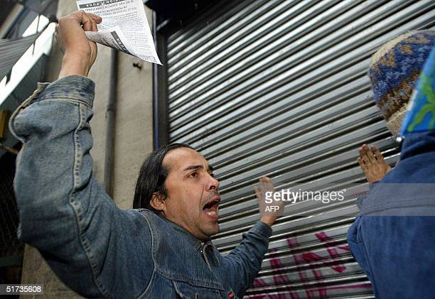 Demonstrator takes part in a protest against the Asia-Pacific Economic Cooperation forum in Santiago, 12 November 2004. Top leaders of 21...