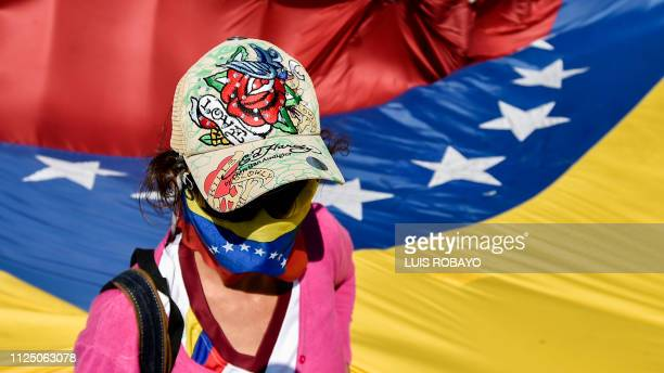 TOPSHOT A demonstrator takes part in a protest of Venezuelans against the government of President Nicolas Maduro at the Simon Bolivar International...
