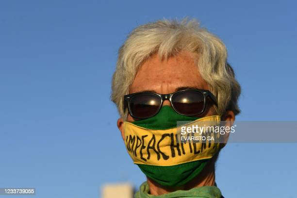 Demonstrator takes part in a protest outside the National Congress in Brasilia, after a request for the impeachment of Brazilian President Jair...