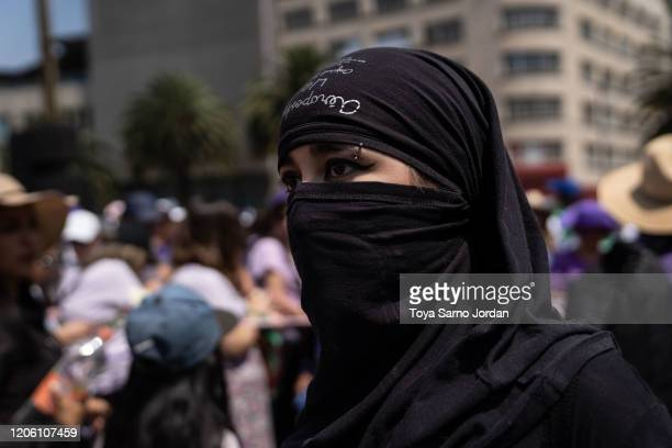 A demonstrator takes part in a rally on International Women's Day on March 8 2020 in Mexico City Mexico
