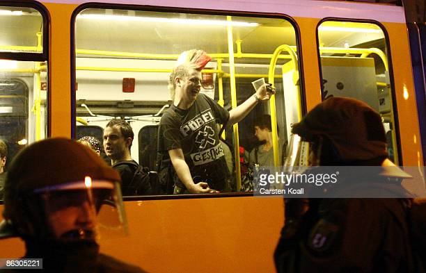 A demonstrator taunts a police officer on the eve of May Day on April 30 2009 in Berlin Germany A spontaneous demonstration with several hundred...