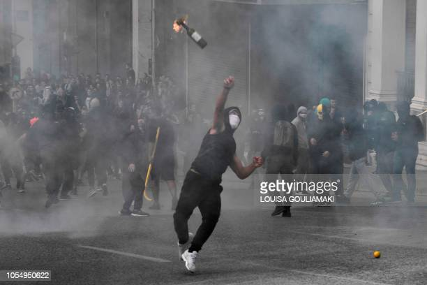 TOPSHOT A demonstrator throws a molotov cocktail towards police as high school students rally and protest against the high school educational reform...