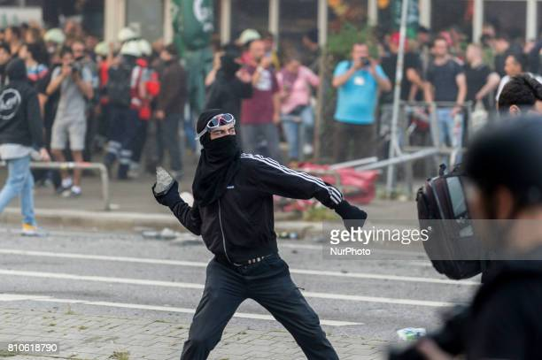 A demonstrator throws a stone towards the police in Hamburg Germany on July 7 2017 In the evening there was a lot of riots in the Schanzenviertel...