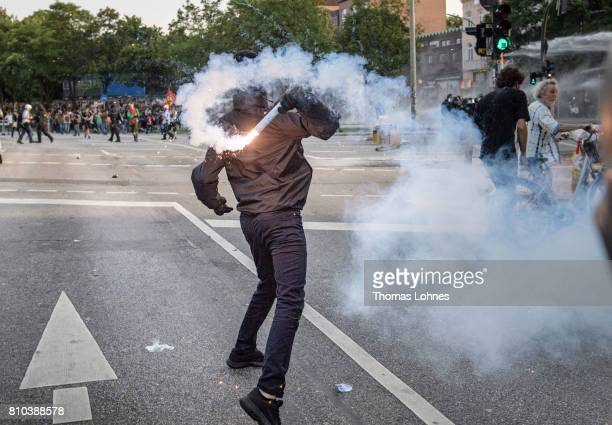 A demonstrator throws firework againt police units during an demonstration against the G20 Summit on July 7 2017 in Hamburg Germany Leaders of the...
