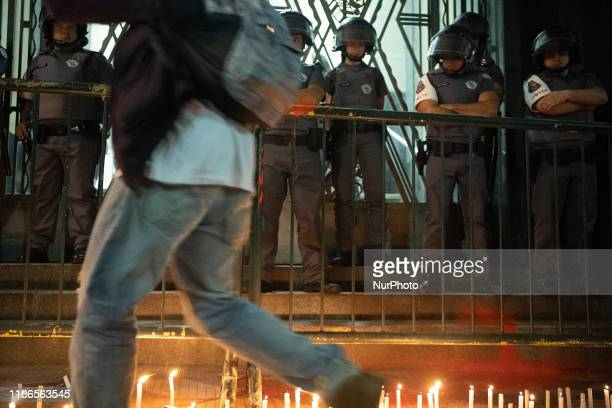 Demonstrator throws red paint alluding to spilled blood during a protest about the death of nine people during a police raid at a Funk Party at...