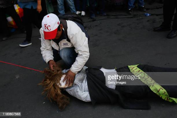 A demonstrator ties a puppet depicting interim President of Bolivia Jeanine Áñez during antigovernment protest in a funeral procession of the victims...