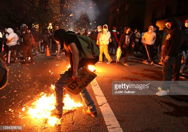 Demonstrator tried to extinguish a trash fire during a protest sparked by the death of George Floyd while in police custody on May 29, 2020 in...