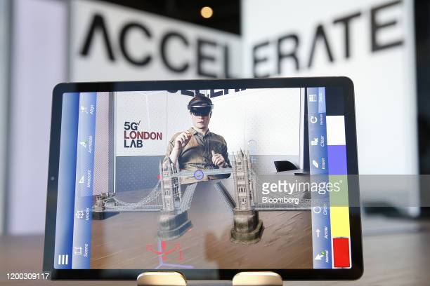 A demonstrator uses a Microsoft Hololens mixed reality headset to demonstrate collaborative software that can be used by architects engineers and...