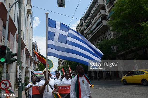 A demonstrator waves a Greek flag A rally in the center of Athens organized from Biafrans that live in Greece to commemorate the victims of Biafra...
