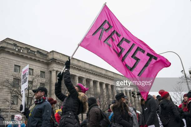 A demonstrator waves a Resist flag at Freedom Plaza during the fourth annual Women's March in Washington DC US on Saturday Jan 18 2020 The...