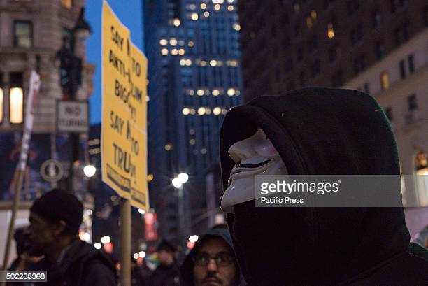 A demonstrator wearing a Guy Fawkes mask participates in the rally at its conclusion near Macy's in Herald Square Several hundred demonstrators...