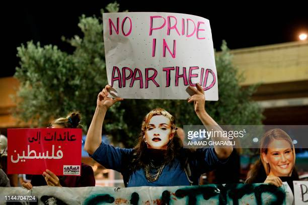 A demonstrator wearing a mask bearing the likeness of American singer Madonna during a protest calling for a boycott of the ongoing 2019 Eurovision...