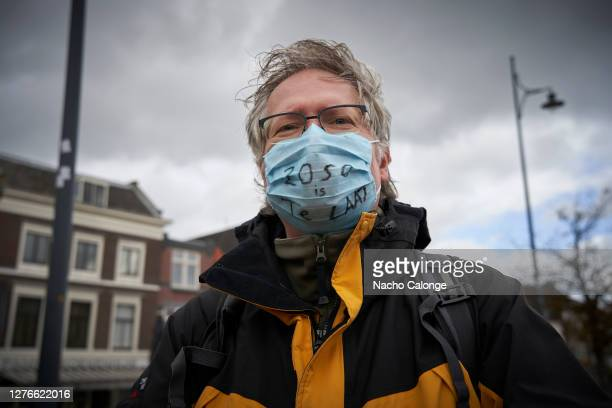 A demonstrator wearing a mask reading 2050 is too late during the global day of climate action on September 25 2020 in Leiden Netherlands Members of...
