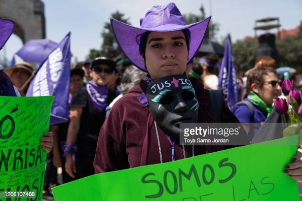 A demonstrator wearing a mask reading justice takes part in a rally on International Women's Day on March 8 2020 in Mexico City Mexico
