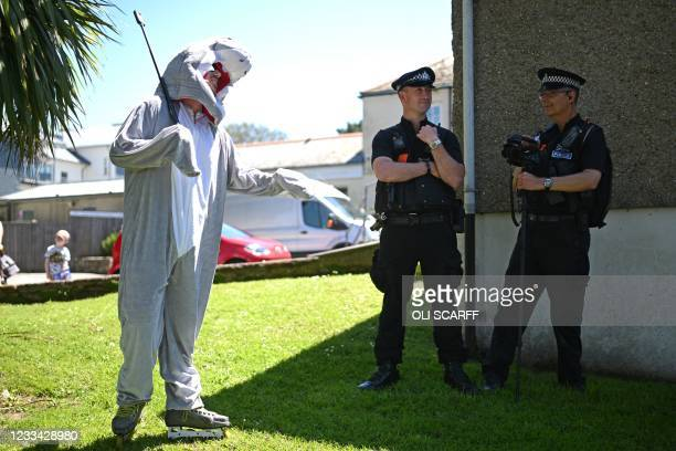 Demonstrator wearing a shark outfit chats to police officers before taking part in a protest against the Police, Crime, Sentencing and Courts Bill...