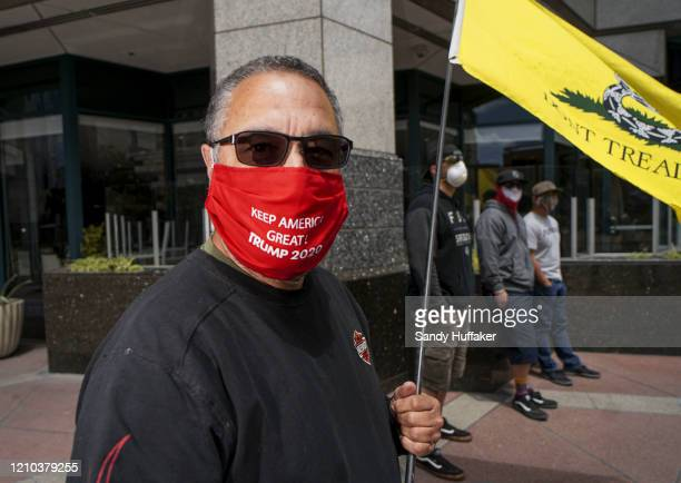 A demonstrator wearing a Trump 2020 mask protests during a Freedom Rally against StayAtHome Directives on April 18 2020 in San Diego California...