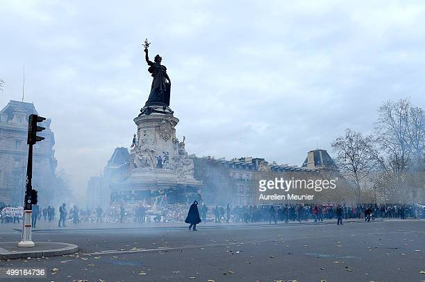 Demonstrator wearing an anonymous mask is seen approaching the police surrounded by gas during the forbidden COP21 demonstration on November 29, 2015...