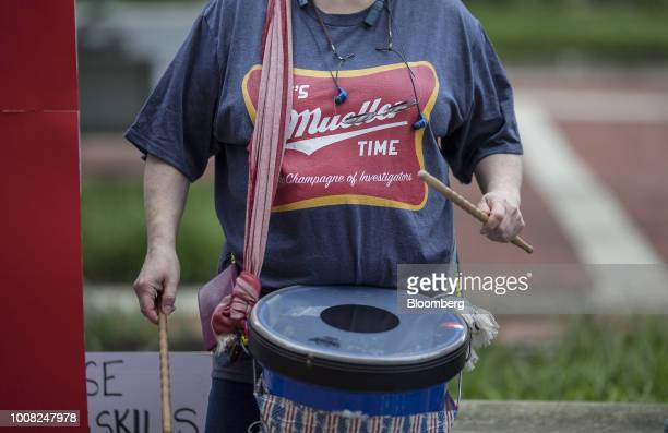A demonstrator wearing an It's Mueller Time shirt beats a drum before the trial of former Trump Campaign Manger Paul Manafort outside of District...
