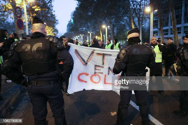 Demonstrator wearing yellow vests hold a banner reading quotangry VTC quot during a protest against the rising of the fuel and oil prices on November...