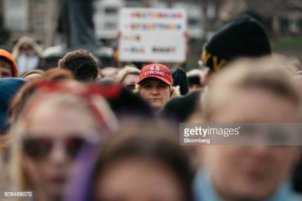 A demonstrator wears a 55 Strong hat during a rally outside the West Virginia Capitol in Charleston West Virginia US on Friday March 2 2018 A week...
