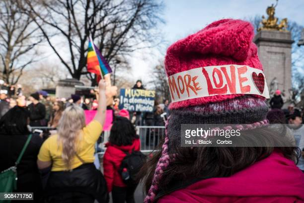 A demonstrator wears a band around their hat that says 'More LOVE' in Columbus Circle during the second annual Women's March in the borough of...