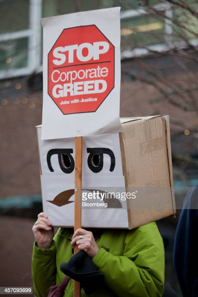 A demonstrator wears a costume during a protest at Amazoncom Inc headquarters in Seattle Washington US on Monday Dec 16 2013 Amazoncom Inc workers in...