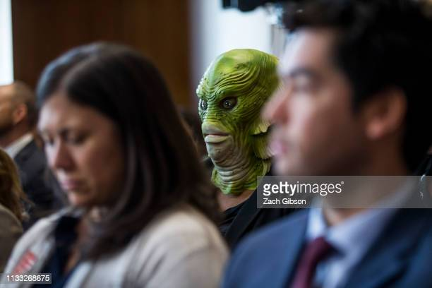 A demonstrator wears a Creature from the Black Lagoon mask as David Bernhardt President Donald Trump's nominee to be Interior Secretary testifies...