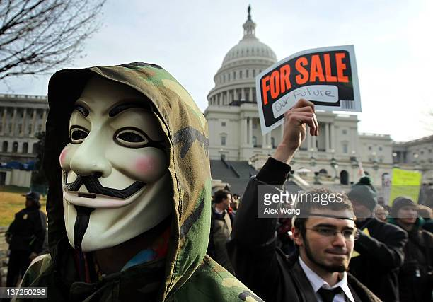 A demonstrator wears a Guy Fawkes mask during an Occupy Congress rally at the West Front Lawn of the Capitol January 17 2012 in Washington DC...