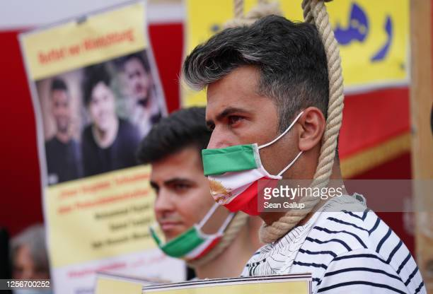 A demonstrator wears a hangman's noose as he protests against executions in Iran at a gathering to demand regime change in Iran on July 17 2020 in...