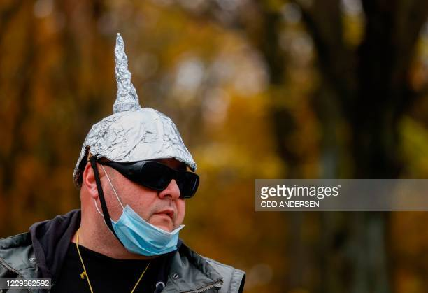 Demonstrator wears a hat made of aluminum during a protest against measures imposed by the German government to limit the spread of the novel...