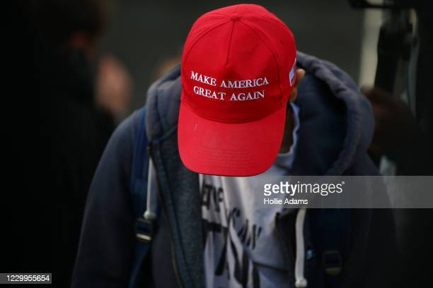 Demonstrator wears a Make America Great Again hat during 'March for Freedom' anti-vaxx protest at Westfield shopping centre in Stratford on December...