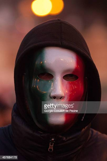 Demonstrator wears a mask as he takes part in the protest of the Forconi Movement at Piazza del Popolo on December 18, 2013 in Rome, Italy. The I...