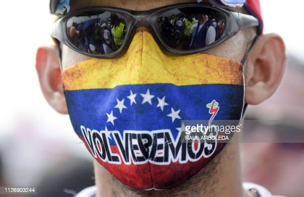 TOPSHOT A demonstrator wears a mask on the Tienditas International Bridge in Cucuta Colombia before the attempt to cross humanitarian aid over the...