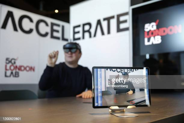 A demonstrator wears a mixed reality headset to illustrate 5Genabled collaborative technology that can be used by architects engineers and...