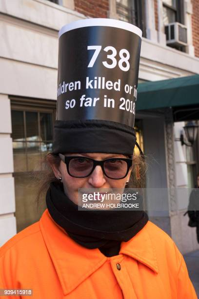A demonstrator wears a sign during the March For Our Lives on March 24 2018 in New York City Thousands of people across the country marched in...