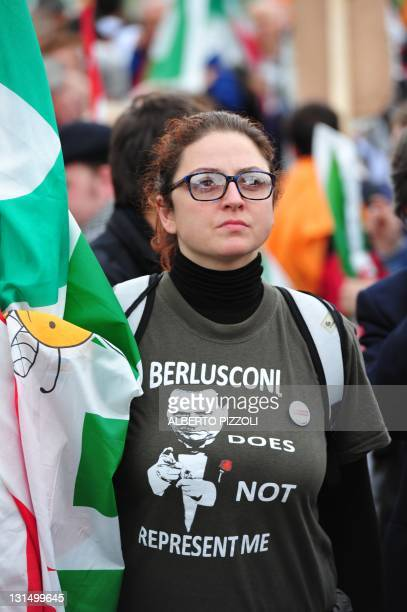 """Demonstrator wears a tee-shirt showing Italian Prime Minister Silvio Berlusconi during a protest untitled """"Reconstruction. In the name of the Italian..."""