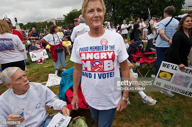 A demonstrator wears a Tshirt against US President Barack Obama in front of the US Capitol during a march by supporters of the conservative Tea Party...