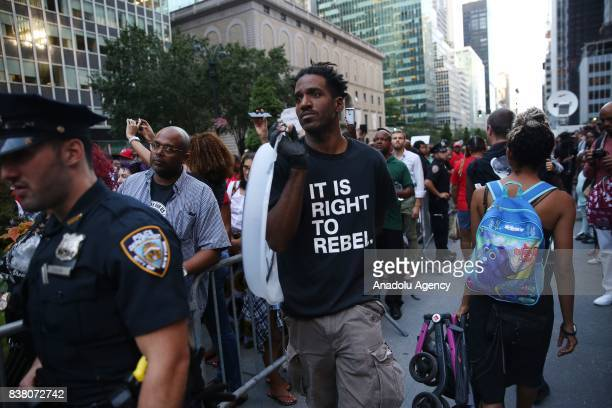 A demonstrator wears a tshirt reading It Is Right To Rebel during a rally against the National Football League supporting Colin Kaepernick in...