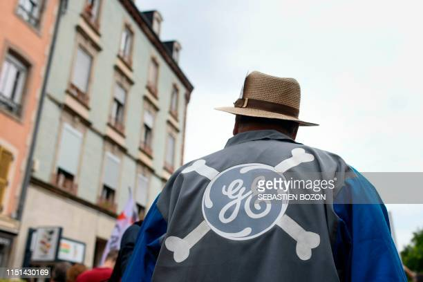 A demonstrator wears a vest with the two letters of General Electrics with two crossed bones during a demonstration held to support the employees of...