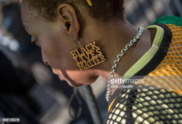 A demonstrator wears 'black lives matter' ear rings during a protest in support of the Windrush generation in Windrush Square Brixton on April 20...