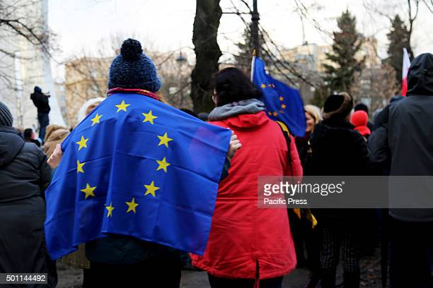 A demonstrator wears the European Union Flag outside of the Polish Parliment the 'Sejm' in Poland's capital Warsaw Over 50 000 people from across...