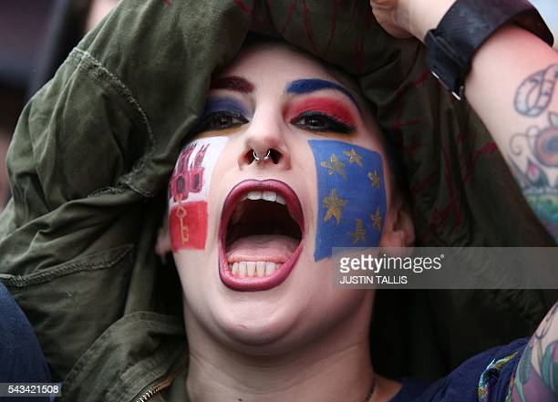 A demonstrator with a European flag painted on her face chants at an antiBrexit protest in Trafalgar Square in central London on June 28 2016 EU...