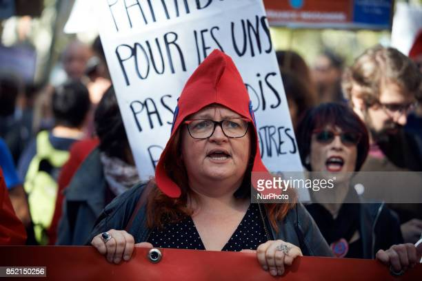 A demonstrator with a phrygian cap shouts slogans against MAcron's policies during a protest in Toulouse against the new Macron's reforms on the Work...