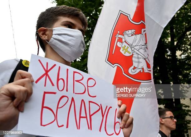 """Demonstrator with a placard reading """"Long Live Belarus"""" rallies in support of Belarusians protesting vote rigging in the presidential election,..."""
